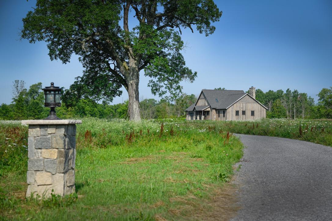 Exterior_Rush_NY_Rustic_Ranch_Vertical_Barnwood_Siding_Stone_Pillar