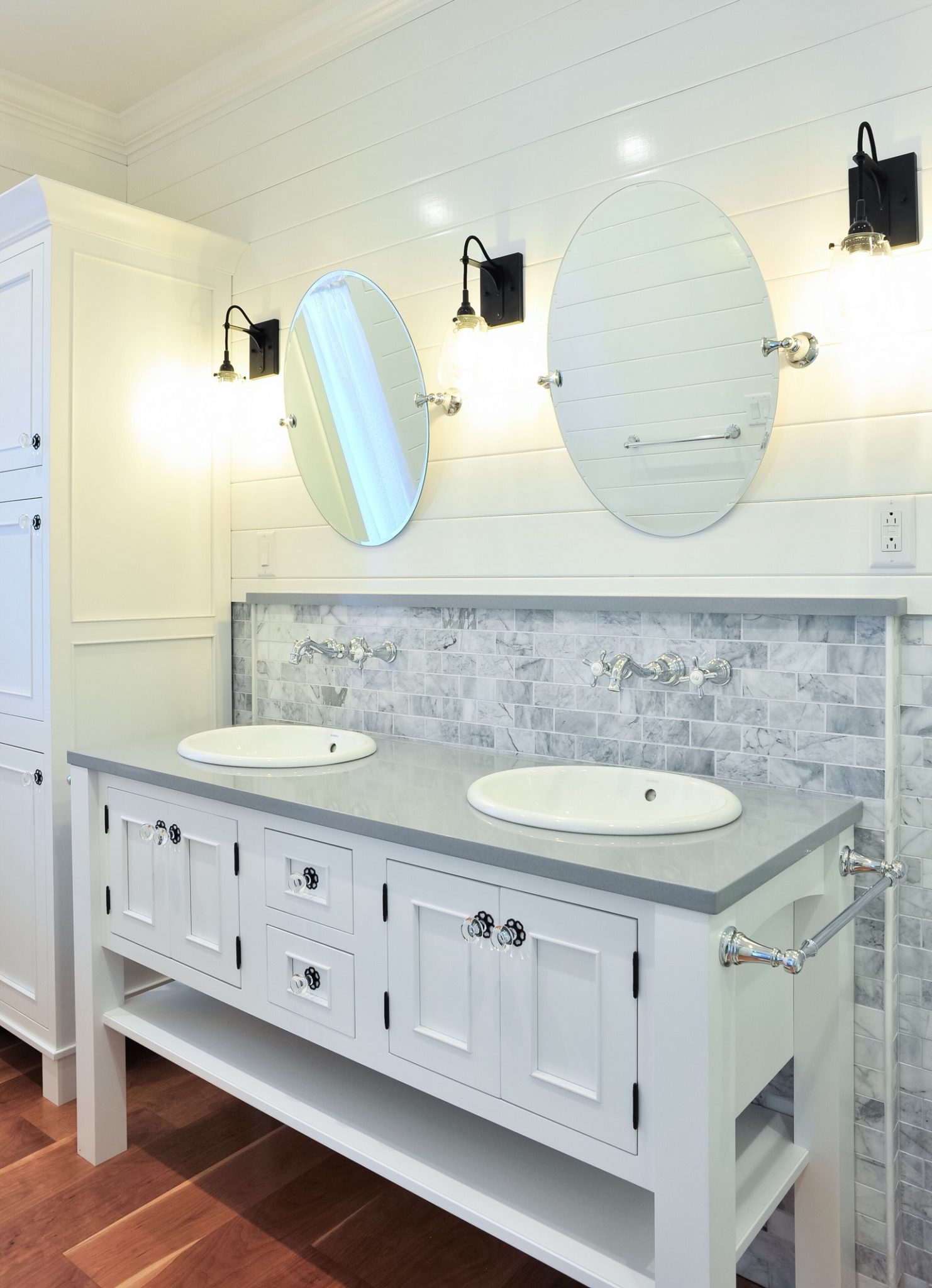 One of our Keuka, NY bathroom remodels with custom inset doors and drawers.